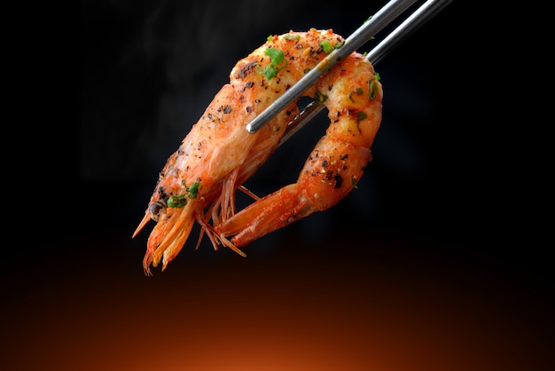 Grill shrimp bbq in chopstick.