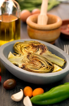 Grilled artichokes and vegetables on the table