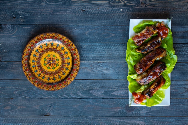 Grilled barbecue pork ribs with vegetables