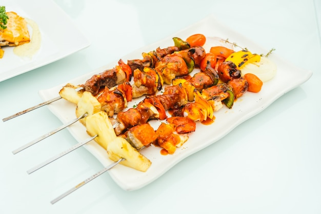 Grilled bbq meat stick in white plate
