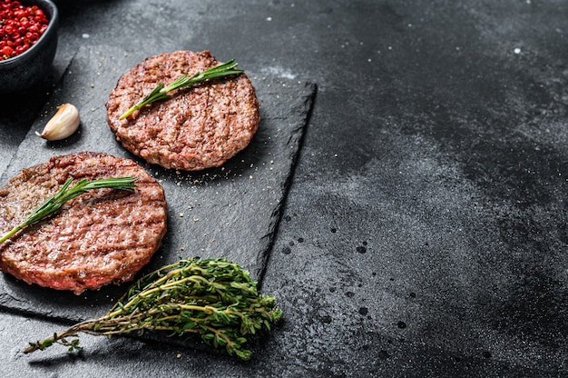 Grilled beef burger patties. meat cutlet.  top view. copy space