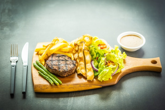 Grilled beef meat steak with french fries sauce