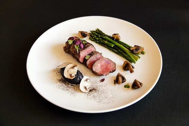 Grilled beef steak meat with asparagus and mushrooms