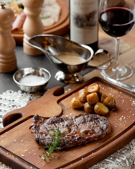 Grilled beef steak served with roasted baby potatoes