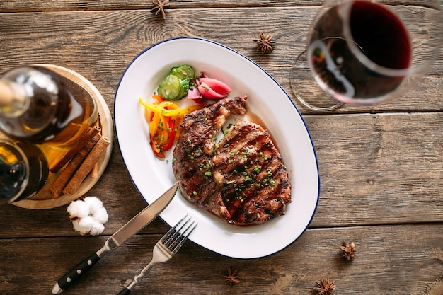 Grilled beef steak with a glass of red wine