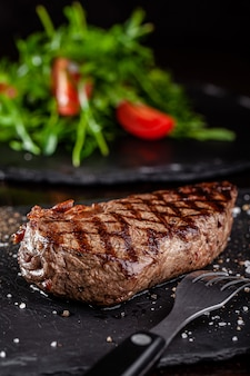 Grilled beef steak with grill