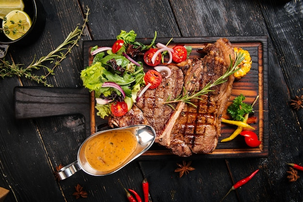 Grilled beef steak with vegetables and sauce