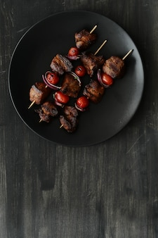 Grilled beef and tomato skewers