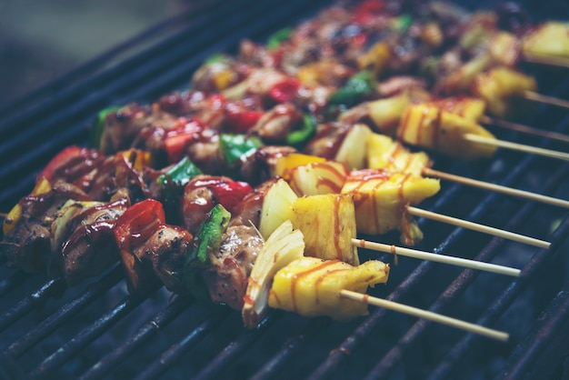 Grilled beef and vegetable bbq skewers on the black background