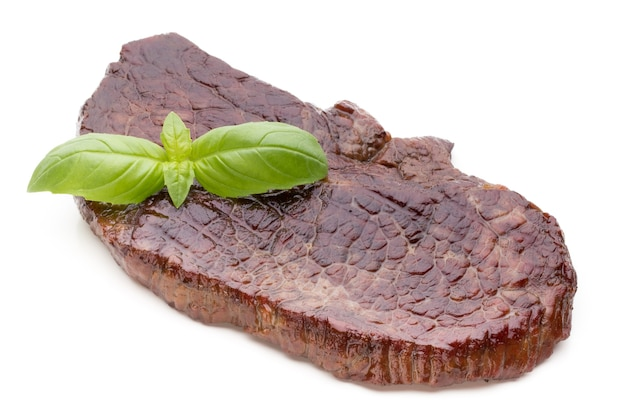 Grilled bio beef steaks with spices isolated on white.
