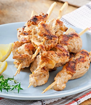 Grilled chicken on bamboo skewers
