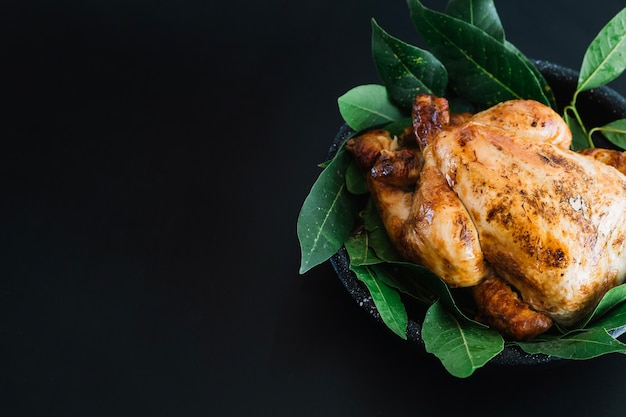 Grilled chicken on bay leaves