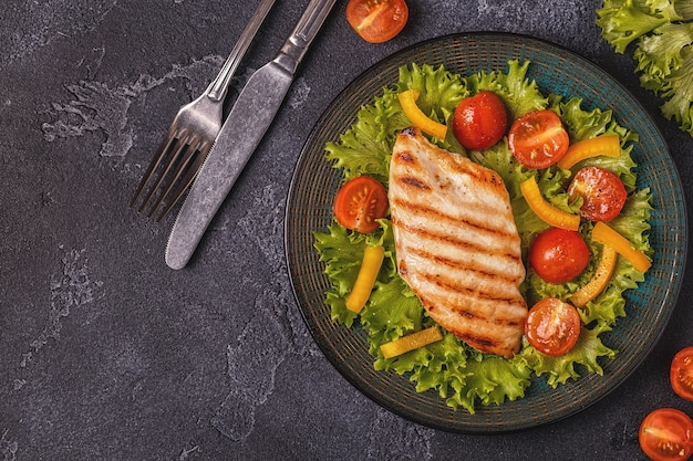 Grilled chicken breast served with vegetable salad