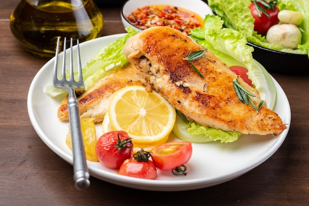 Grilled chicken breast and vegetable salad on the plate