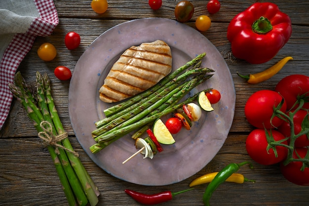 Grilled chicken breast with brochette vegetable