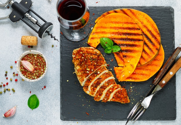 Grilled chicken breast with spices and pumpkin slices