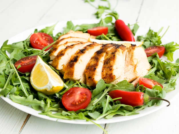 Grilled chicken breasts with vegetables