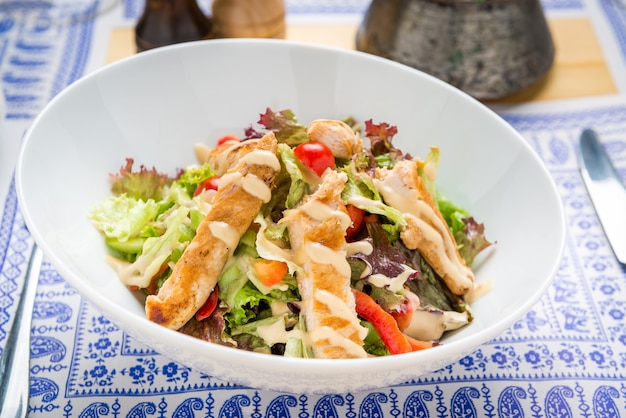 Grilled chicken caesar salad with cheese and croutons