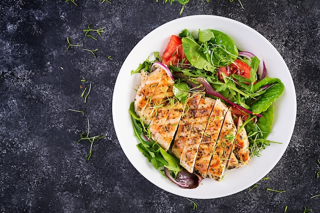 Grilled chicken fillet with salad. keto, ketogenic, paleo diet. healthy food.  diet lunch concept. top view, overhead, copy space