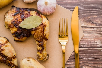 Grilled chicken leg quarter on table