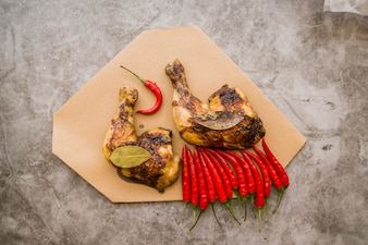 Grilled chicken leg quarters on table