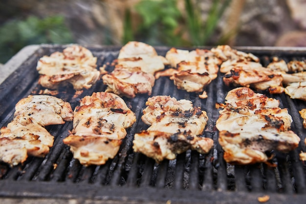 Grilled chicken legs with smoke from the grill coals. bbq party.