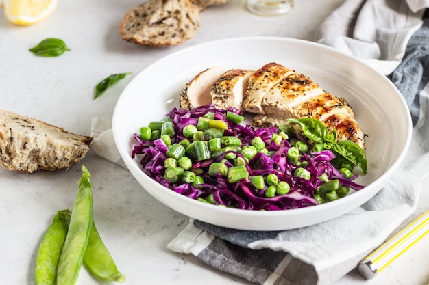 Grilled chicken, red cabbage, green peas and beans