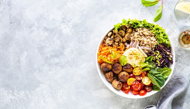 Grilled chicken, rice, spicy chickpeas, avocado, cabbage, pepper buddha bowl on white surface, top view. delicious balanced food concept