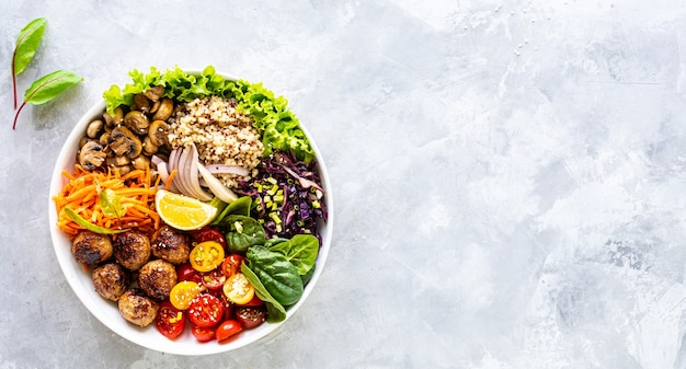 Grilled chicken, rice, spicy chickpeas, avocado, cabbage, pepper in buddha bowl