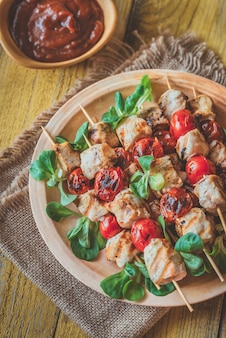 Grilled chicken skewers on the plate