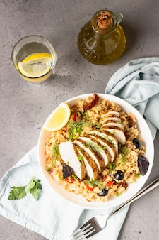 Grilled chicken or turkey with rice and vegetables.