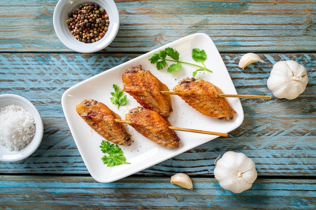 Grilled chicken wings barbecue with pepper and garlic
