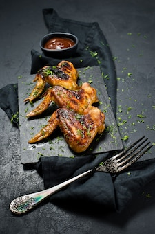 Grilled chicken wings in honey marinade.