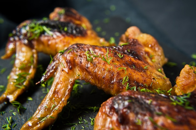Grilled chicken wings in honey sauce.