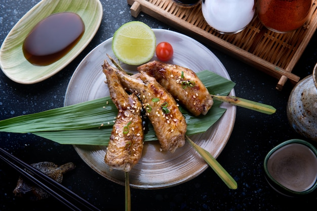 Grilled chicken wings with teriyaki sauce.