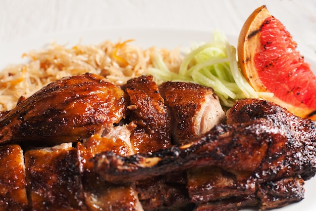 Grilled chicken with fresh vegetables close-up