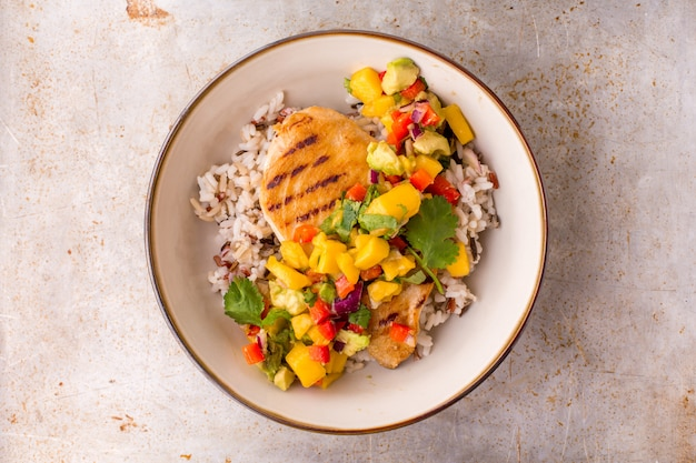 Grilled chicken with mango avocado salsa and rice