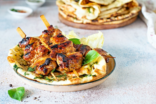 Grilled chicken with spices and tzatziki sauce