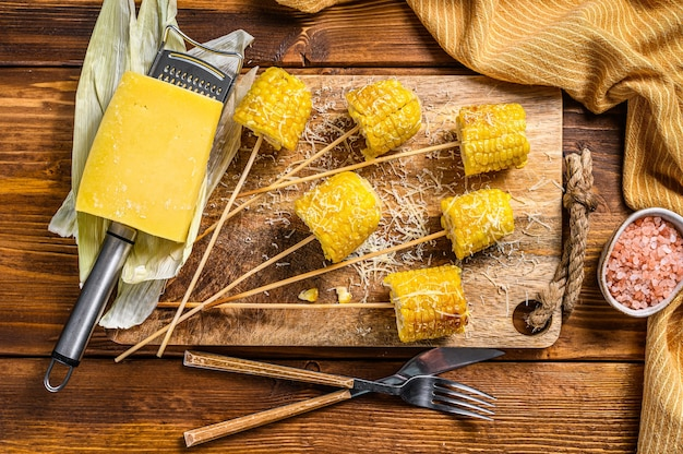 Grilled corn with a sprinkle of cheese, mexican elotes