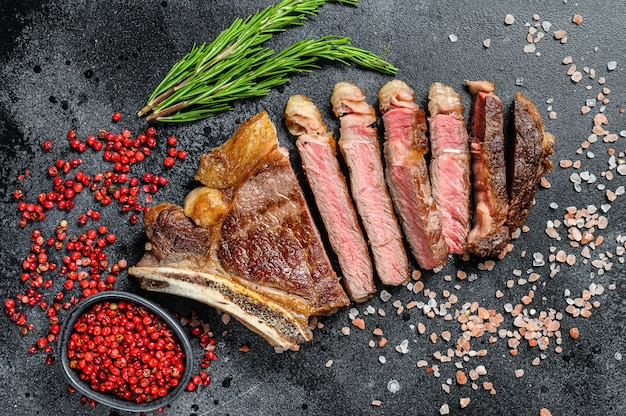 Grilled cowboy or ribeye beef steak with herbs and spices