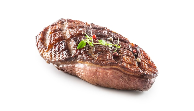 Grilled duck breast on an isolated white background.