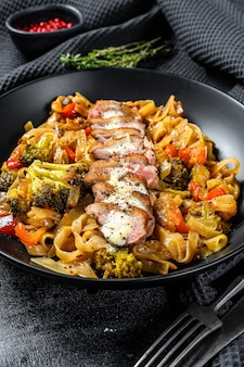 Grilled duck breast with udon noodles and vegetables