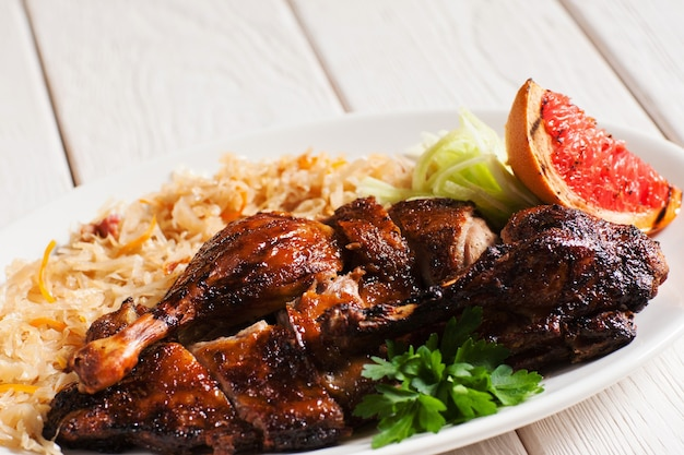 Grilled duck served with stewed cabbage and grapefruit slice