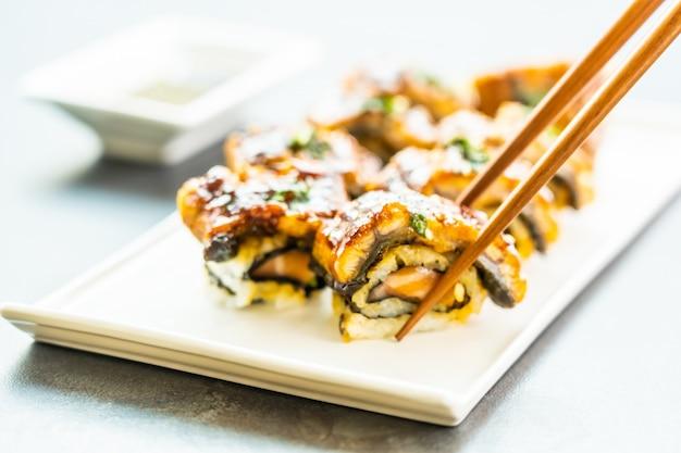 Grilled eel or unagi fish sushi maki roll with sweet sauce
