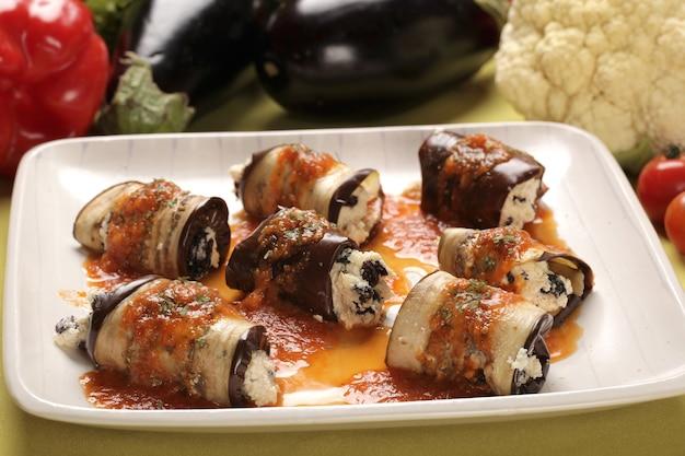 Grilled eggplant roll-ups with ricotta pesto. italian cuisine