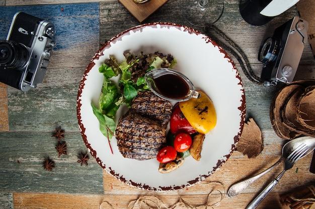 Grilled fillet mignon steaks vegetables and sauce