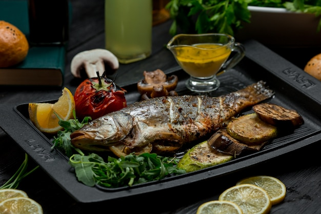 Grilled fish barbecue with vegetables and dip sauce