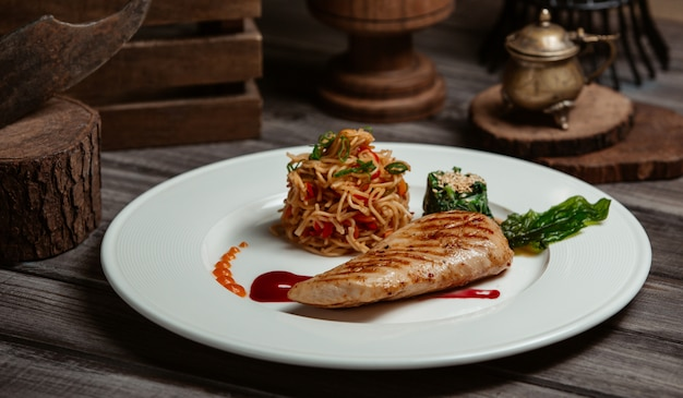 Grilled fish fillet with spaghetti in tomato sauce