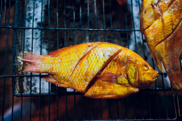 Grilled fish is used on the charcoal grill, a popular food at the evening market in thailand.