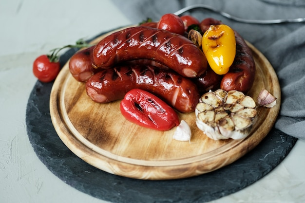 Grilled food on wooden board